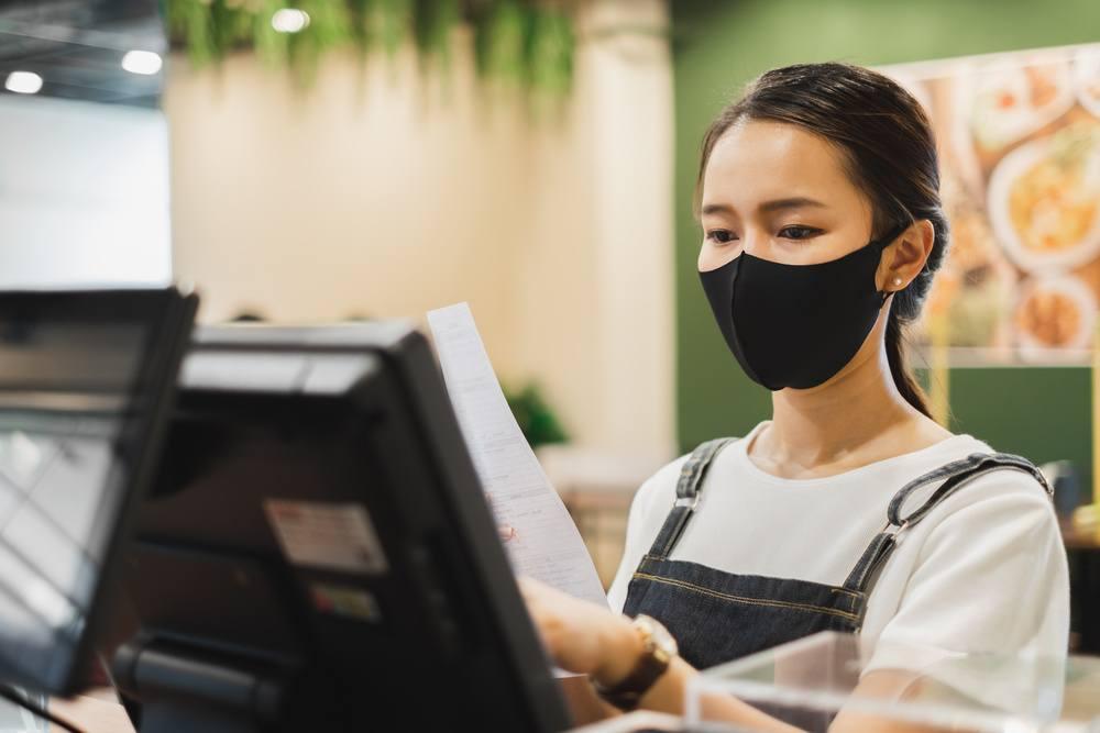 woman at checkout computer